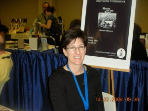 The wonderful Dana Leonard of Miami University Press, in front of a poster for MAYOR OF THE ROSES