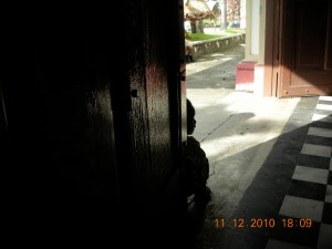 Sunday Mass in Talisay (A young boy squats by the door)
