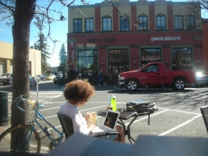 Relaxing.  On the sidewalk in front of Peet's.  It was a GORGEOUS afternoon!