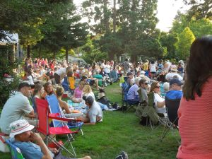 As the summer continues, the crowd gets progressively larger.  By August, you won't see an inch of grass.