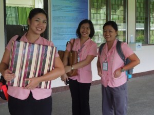 Look at the great smiles on the faces of these teachers at Pampanga Agricultural College, in Magalang, Pampanga!  One of the teachers holds a present they gave self when she visited, in September.
