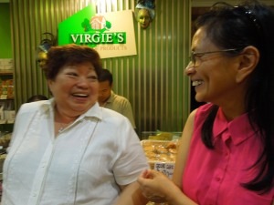 The woman in the white top is Virgie's, creator of THE quintessential Visayan mango tart, and other sinful indulgences:  in Bacolod, where else?