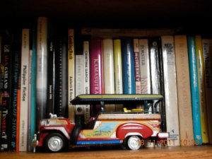 Someone -- self doesn't remember who -- gave us this little jeepney a long time ago, and it's been on her bookshelf ever since.