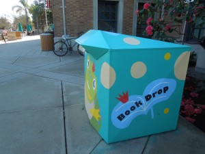 The book drop boxes, which self uses when the library is closed, are painted in cheerful colors.