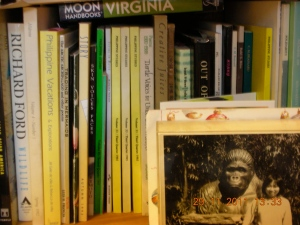 On one of self's bookshelves is a picture of her at the San Diego Zoo, standing next to a mean-looking gorilla.  She was a grad student in Stanford.