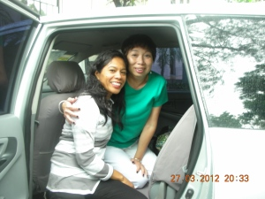 Gemma, chef at the Negros Museum Café, and Self, 2012. Whose car is that?  Self forgets.