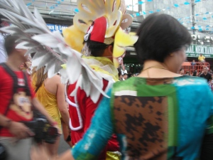 Masskara Street Festival 2012, somewhere in downtown Bacolod.  That's her cousin with her back to the camera, next to the street dancer.