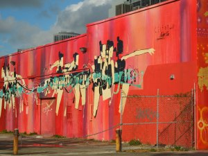 These ballet dancers move along a wall on a street in dowtown Miami (November 2013).