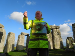 Pat Shelley, who led the Stonehenge tour self took, standing between the stones to give a lecture on the significance of the stones and their positions.