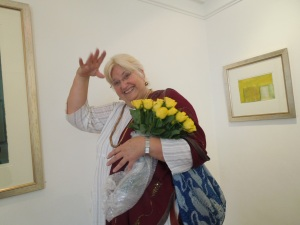 "The ""Something Extra"":  The hand, the smile, the armful of yellow roses"