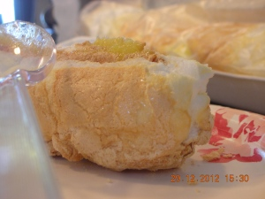 Brazo de Mercedes:  a butter and egg yolk filling is encased in an outer shell of light meringue.  Yummm!