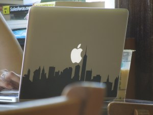 Still in Boba Loca: The laptop of the young woman sitting across from me had a cover adorned with a silhouette of the New York City skyline.
