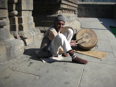 Waiting for alms just outside the entrance of the Shiva Temple
