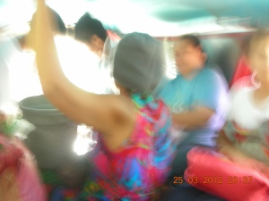 It is hard to take a clear shot inside a jeepney, especially when there is a constant movement of people getting on and off.