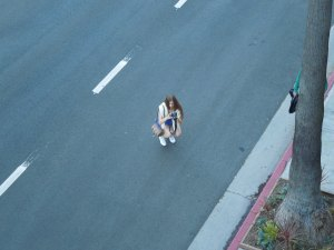What did this woman think she was doing, taking a picture from the middle of a busy street in Venice, California?