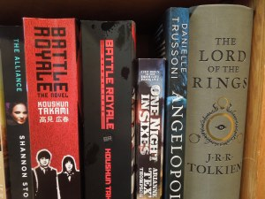 Gallery Bookshop, Main Street, Mendocino: A shelf in the science fiction section (BATTLE ROYALE meets LORD OF THE RINGS)