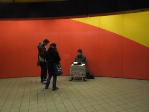 "Man doing ""Poetry Upon Request"" near the IRT-Lexington Subway in New York City"
