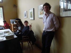 Jeff Millar, Writing Studio Program Coordinator, at the Book Table at the Back of Bentley Chamber Music Studio,