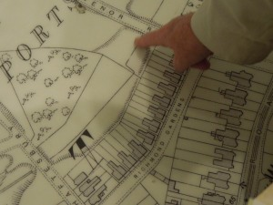 Joan McGavin pointing to (something?) on the floor map of Southampton at the Sea City Museum: July 2015
